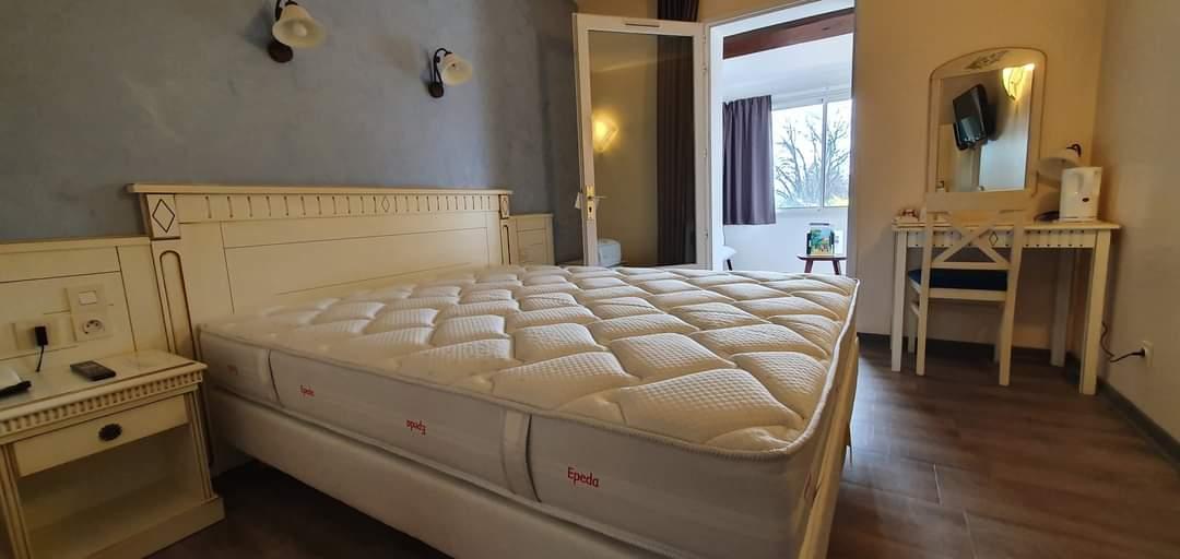 Nouvelle literie Hotel Le Mas Du Colombier